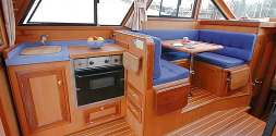A large head with shower and teak bottom grill serves the whole boat.